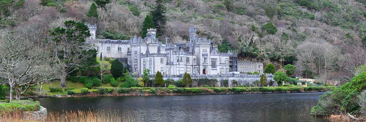 Ireland: A castle situated beside a river.