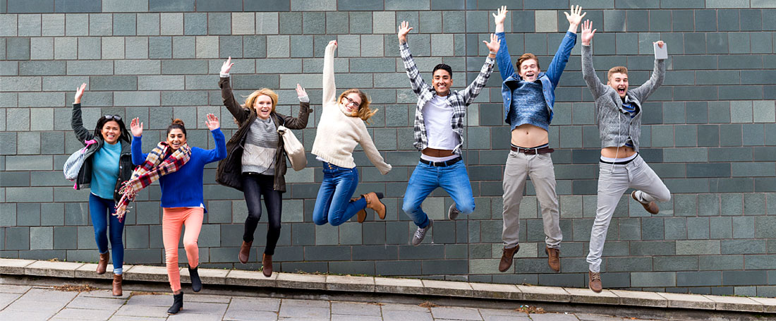 A group of young people jumping
