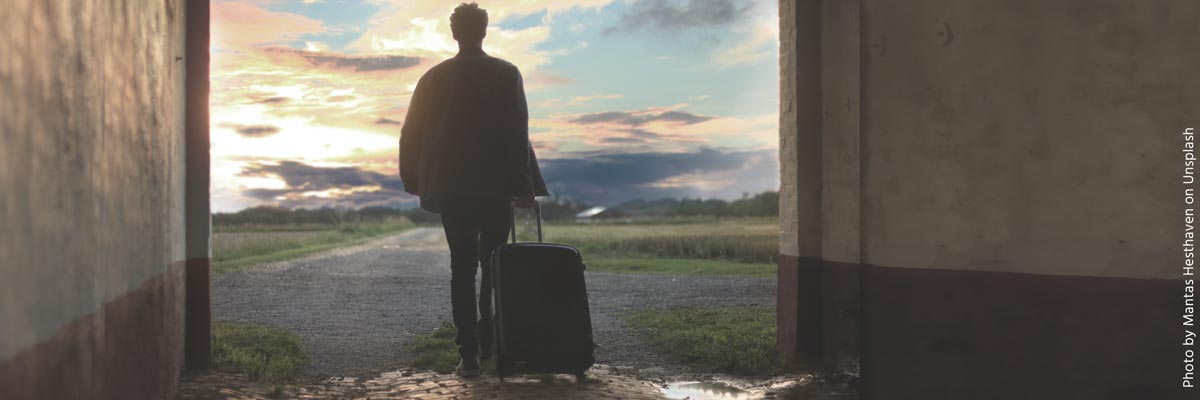 Someone who walks with a suitcase