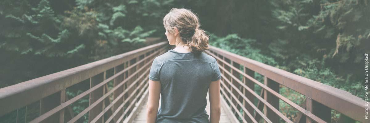Young Woman walking over a bridge