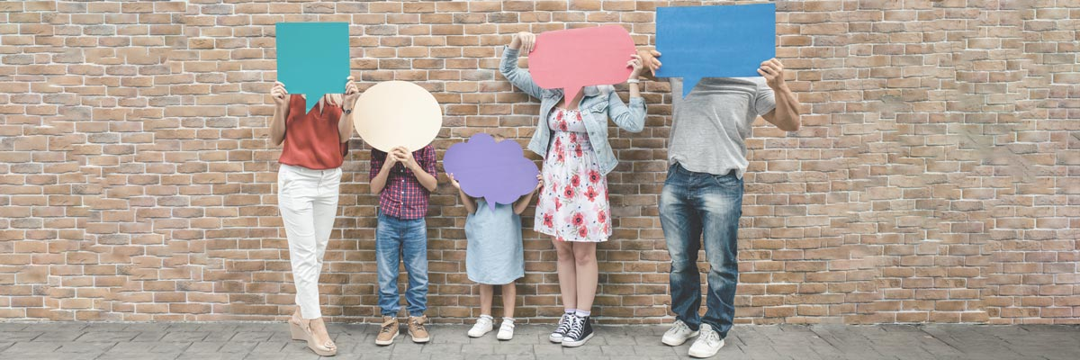 Family holds speech balloons in the air