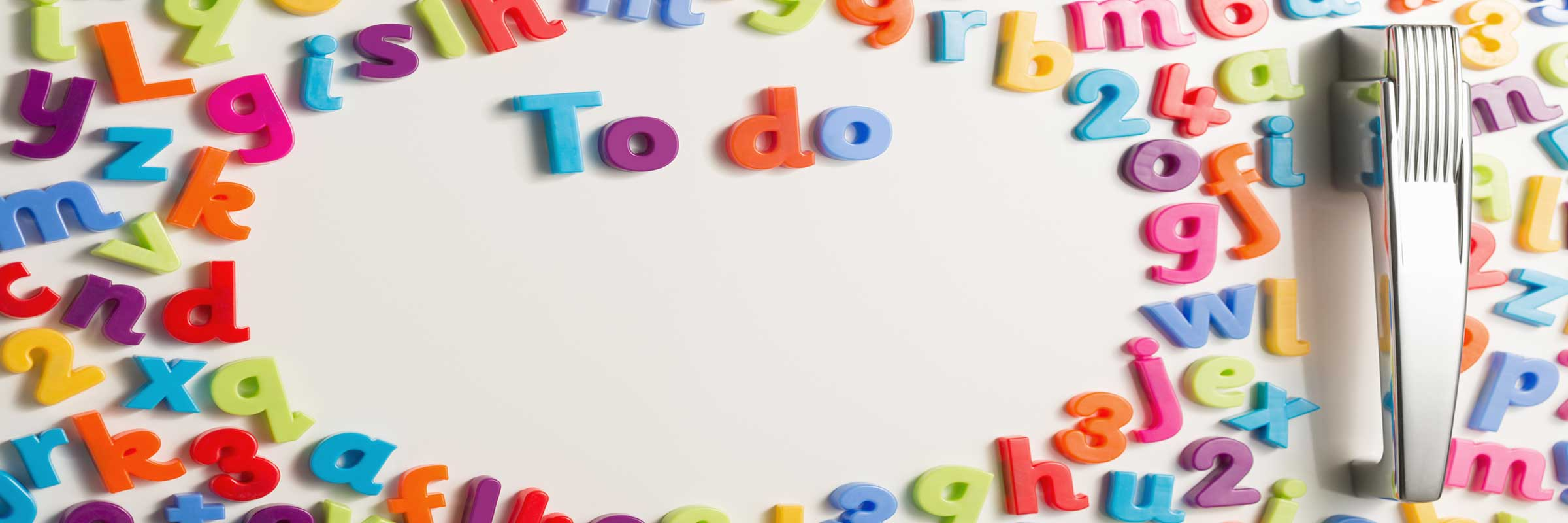 "A refrigerator door with magnetic letters that spell ""To Do""."