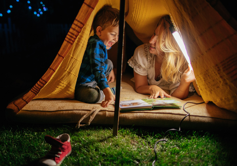 Au pair with child in an tent