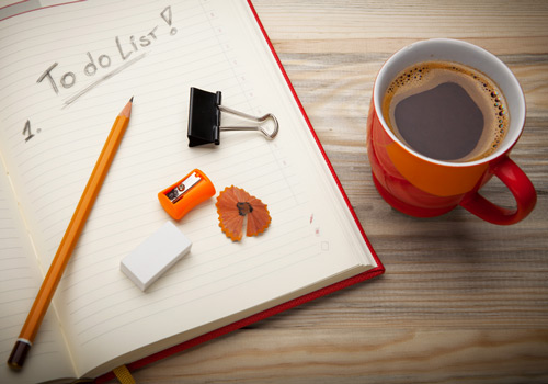 To do list and a coffee cup