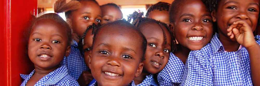 Children at an African school smile for the camera