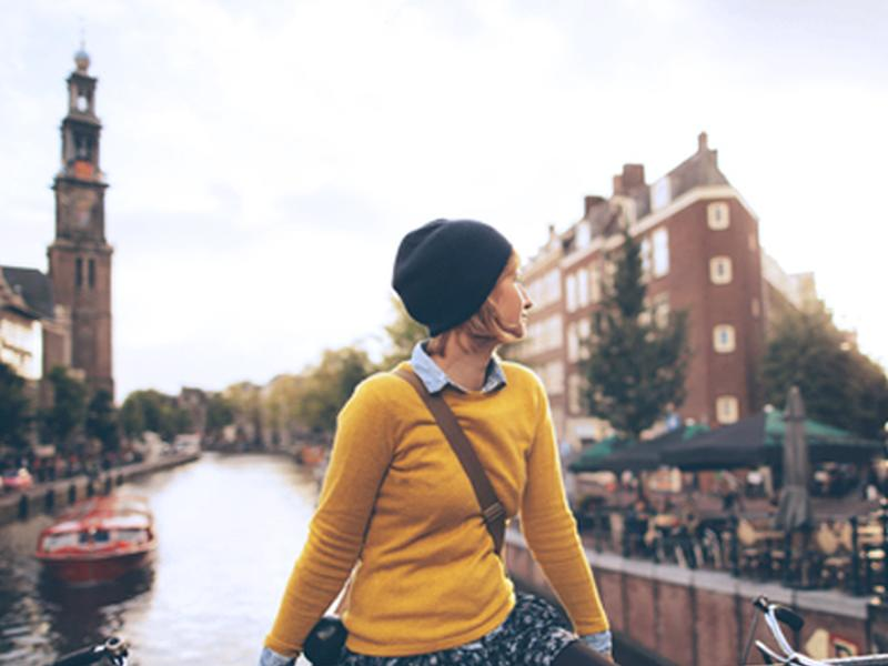 A young woman on a bridge in Amsterdam