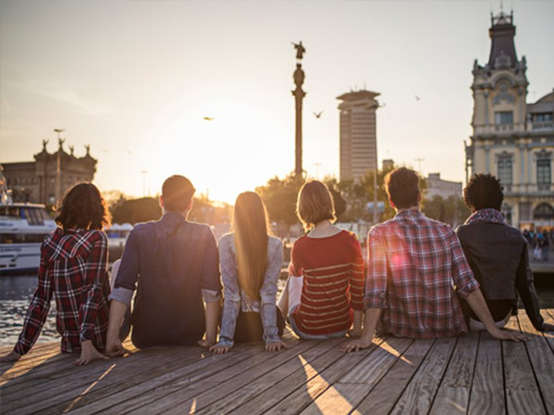 A group of young people at sunset