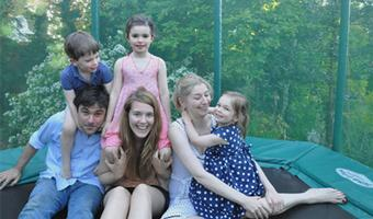 Karine's children and their au pair on a trampoline