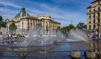 City centre of Munich with a fountain on a sunny day