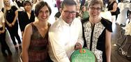 Ann-Kristin Cohrs, Uwe Regenbogen and Heike Fischer around the AuPairWorld birthday cake