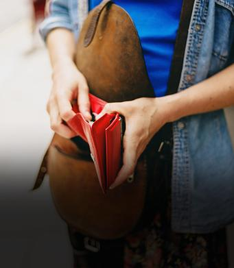 Young woman with wallet