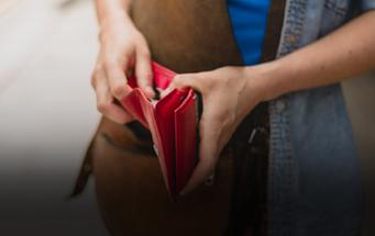 Young woman with a wallet in her hands