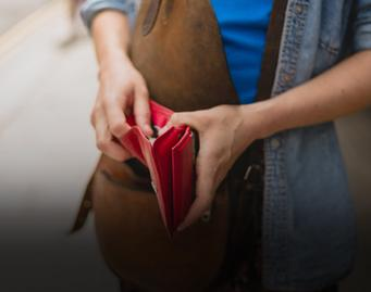 Young woman holding a wallet in her hands